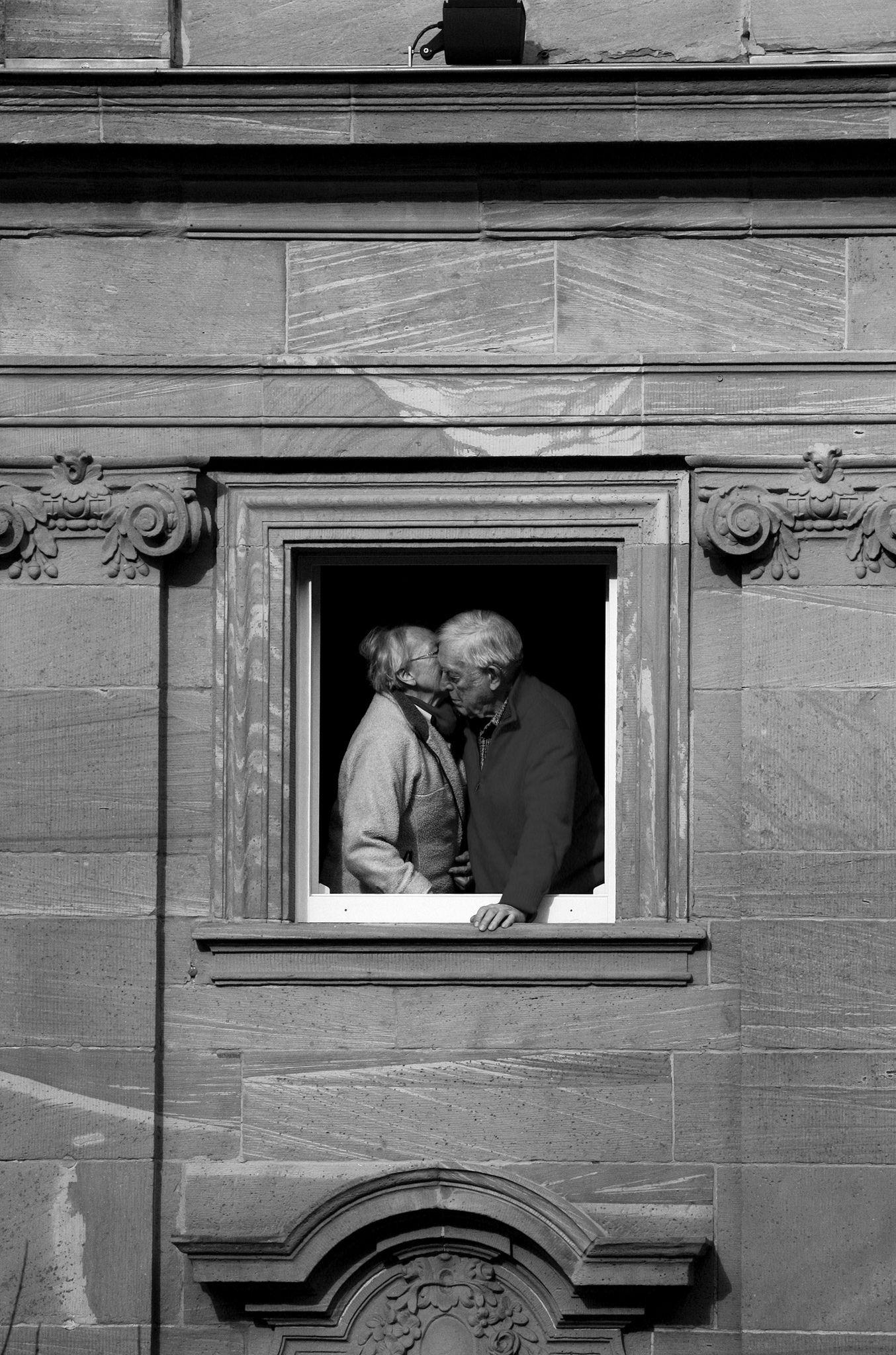 An old couple Windows The World