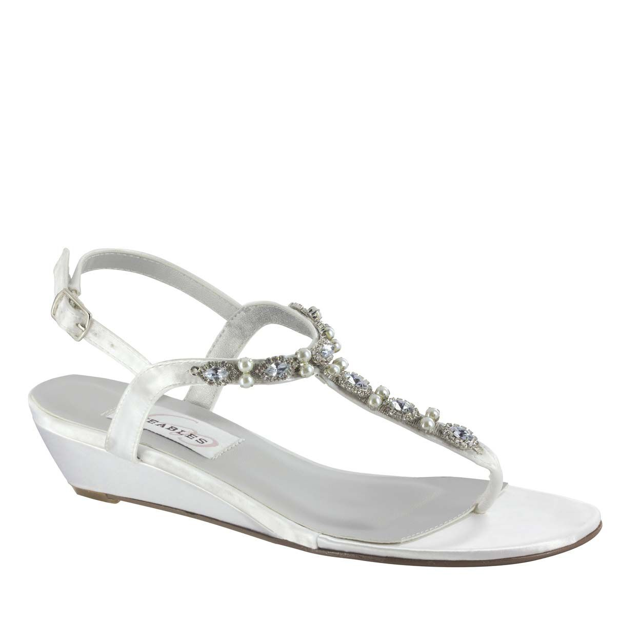 This sexy wedge shoe works great for outdoor gatherings or as a second pair of comfort shoes for your reception. #WeddingShoeInspirations