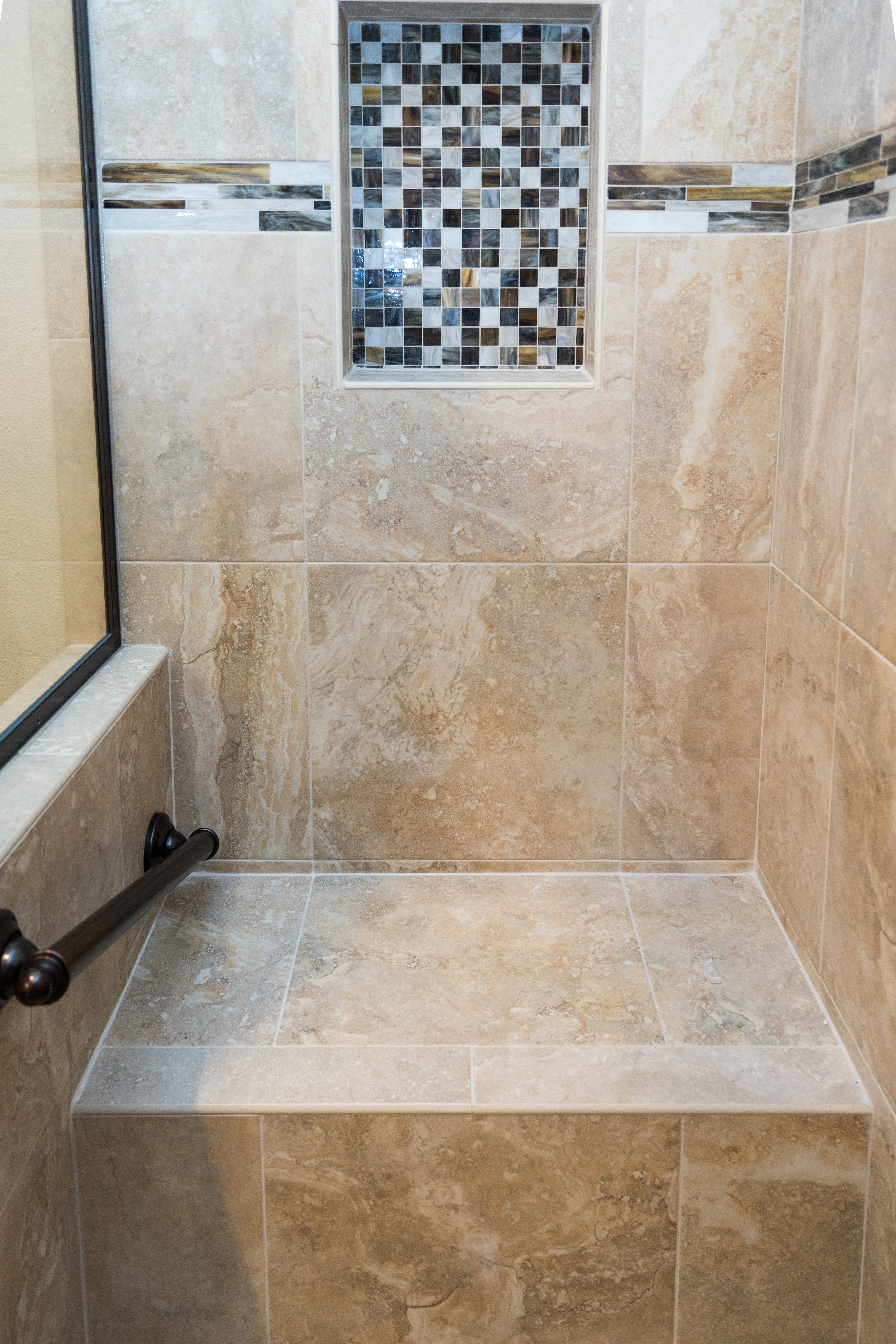 This bathroom remodel is a breath of fresh air With a modern vanity with an integrated sink and a unique shaped shower and travertine floors