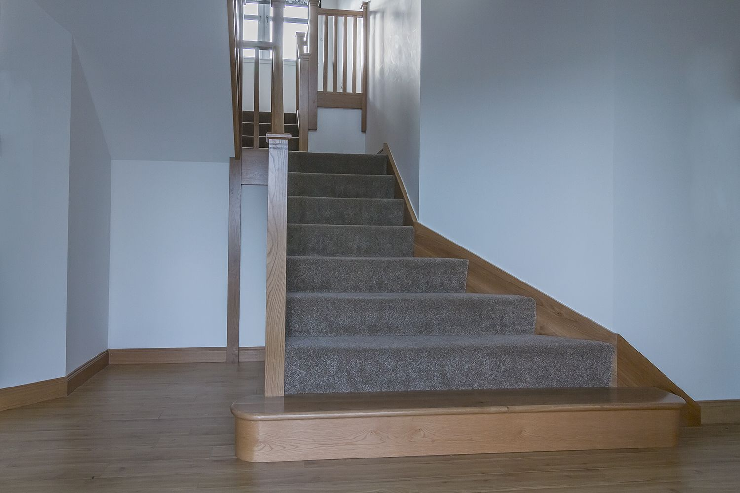 Best Solid Oak Fully Carpeted Stair With Wrap Around Stringers 400 x 300