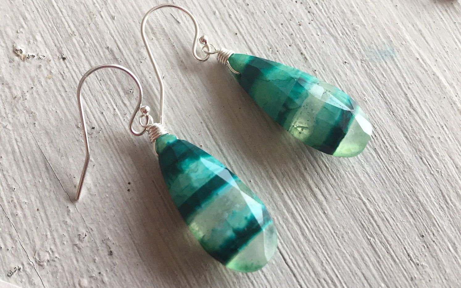 Best 12 These are fun and colorful lab created bead grade Boulder Opals in Blue and Green hues. All pieces are One of