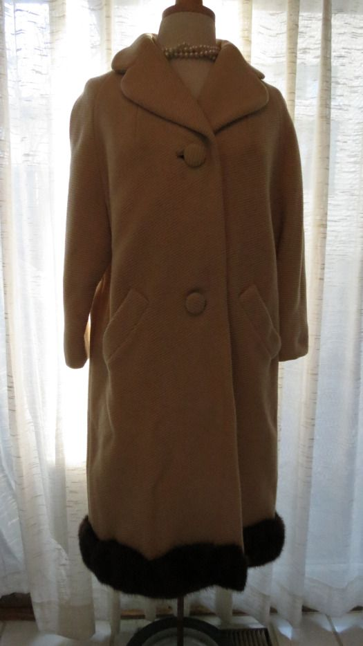 An elegant and surprising #1950's true #vintage #winter #coat in #wool, with #mink trim at the hem.  What an unexpected touch on a classic and understated garment - the epitome of elegant vintage design. Worth a second look. What will turn up next?!  You just never know . . . . .   Morgana Martin, the Magicvintagespy Blog:  Magicvintagespy.com Book:  How to Find the Best in Vintage Fashion available on Amazon.com