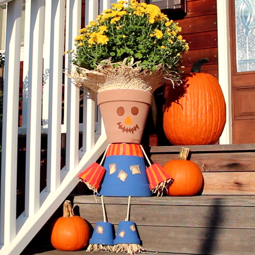 Turn terra cotta pots into a charming scarecrow for Homemade garden decor crafts