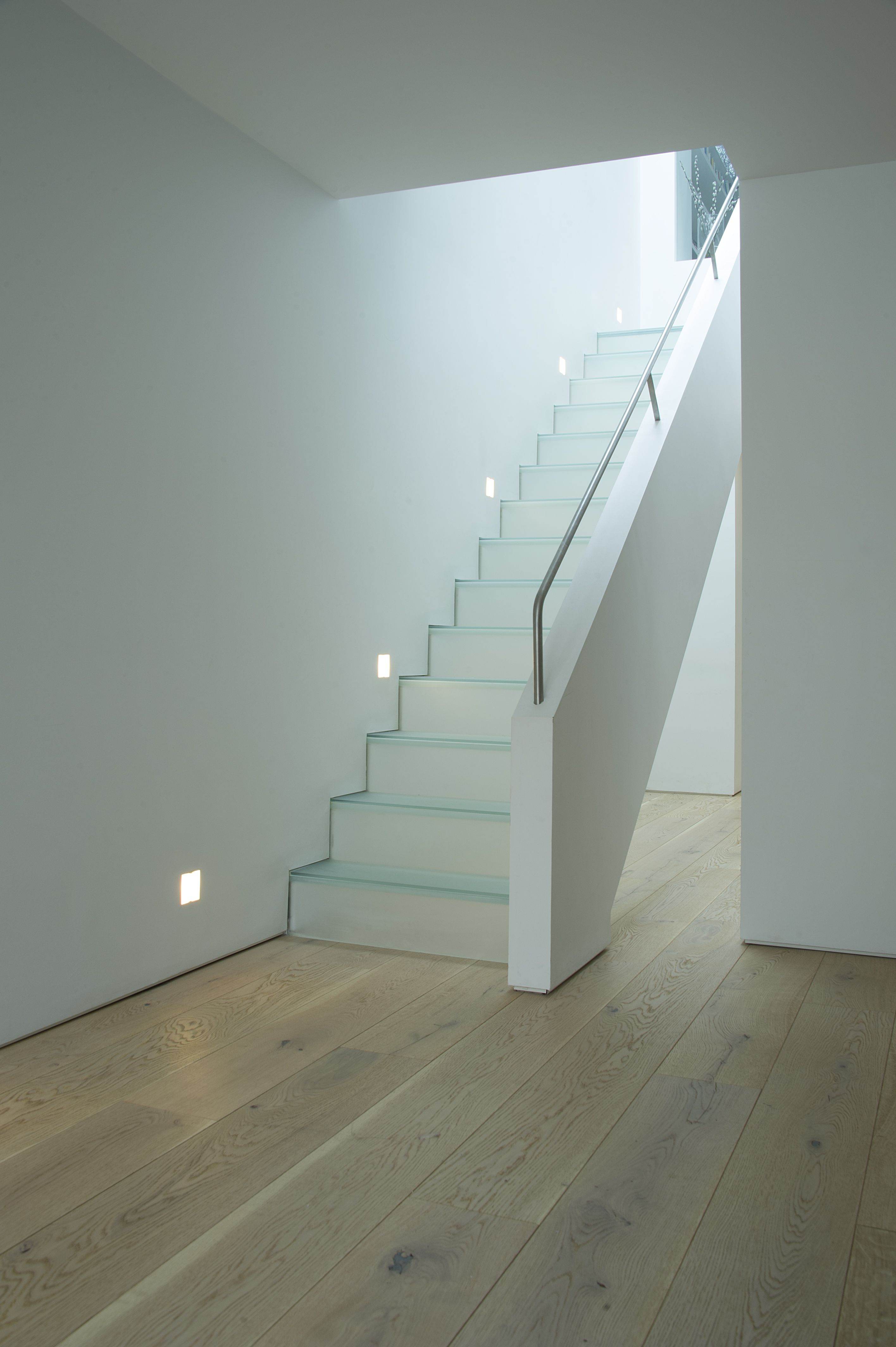 glass stair with plaster balustrade and stainless steel handrail