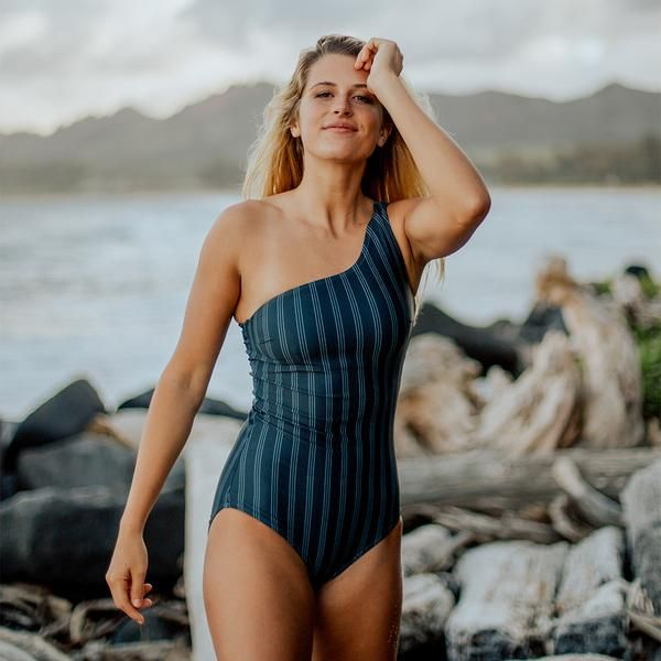 cfbbfaff014 A classic silhouette that is feminine and timeless. This favorite One-piece  style is