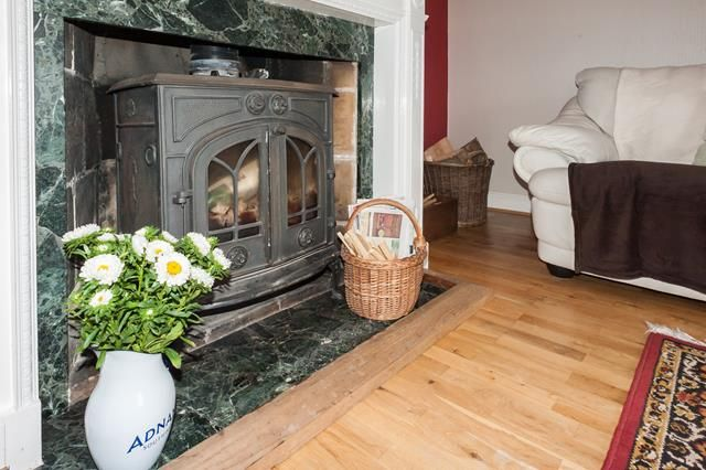 The large woodburner for cosy nights in at Walnut Farmhouse holiday