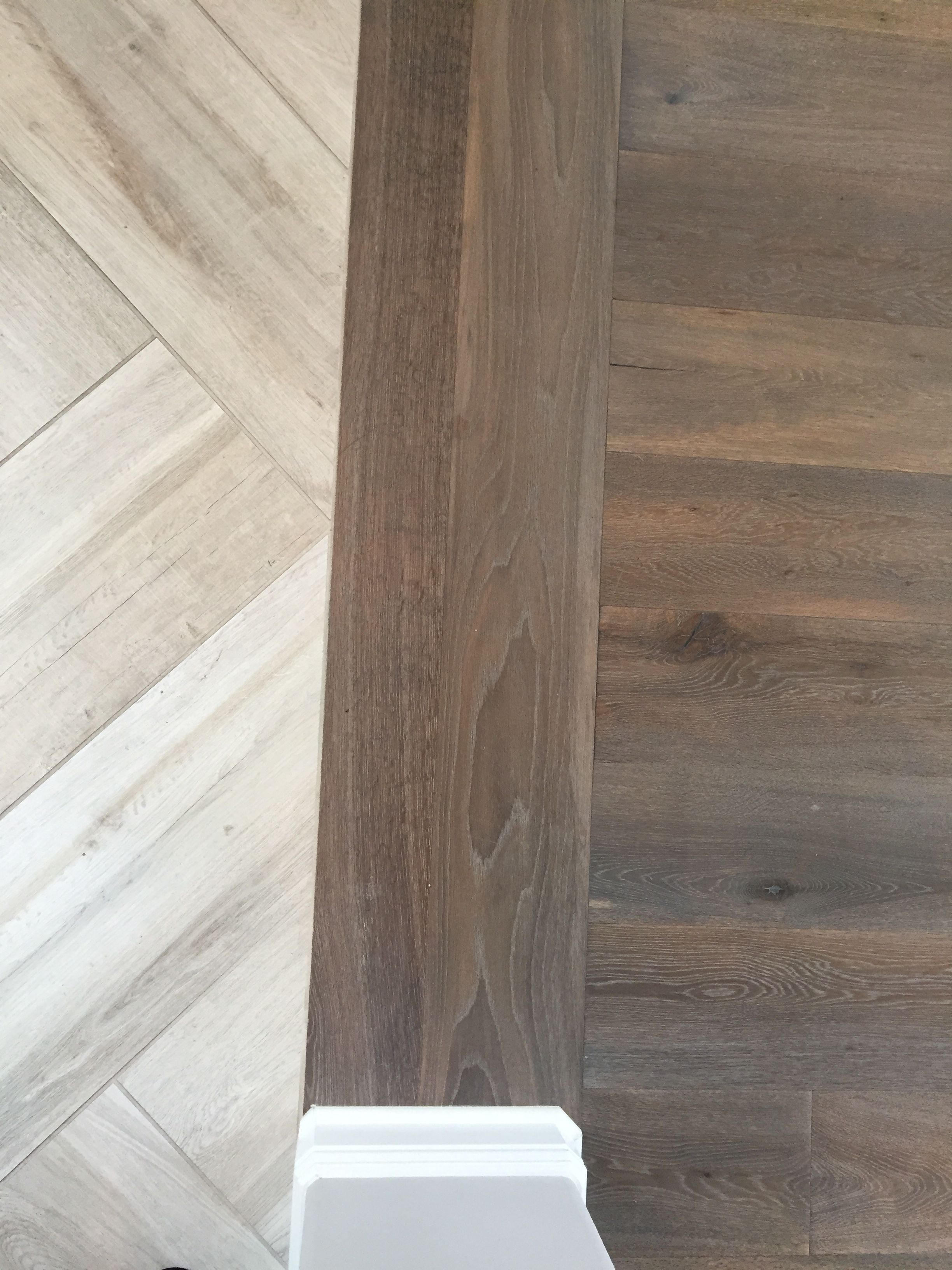 Floor transition laminate to herringbone tile pattern for Tile and hardwood floor