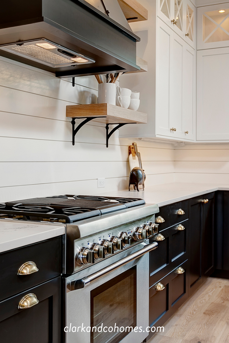 This Kitchen Is A Perfect Example Of Mixing Metals From The Stainless Steel Black Stainless Steel Appliances Kitchen Appliances Luxury Kitchen Cabinet Styles