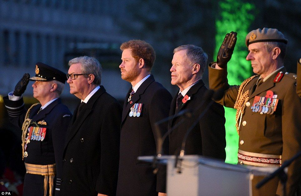 The Prince stands alongside saluting military officials as the memorial ceremony continues at the Hyde Park Corner monument