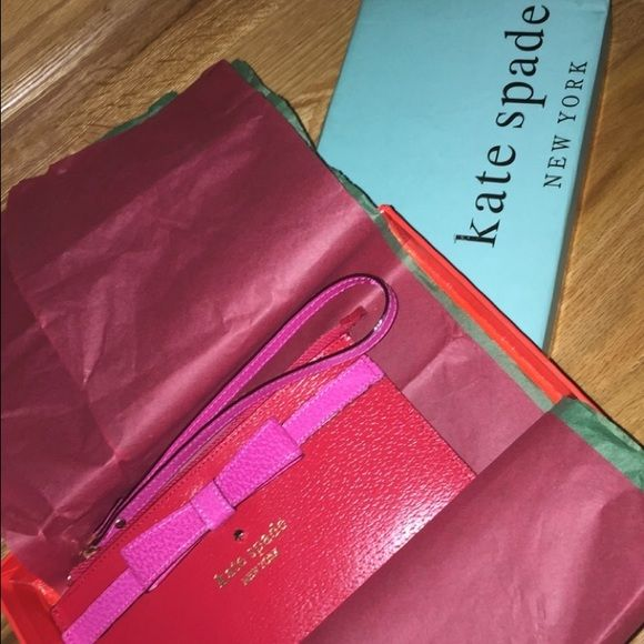Kate spade red and pink bow clutch/wristlet New with tags in original packaging !! kate spade Bags Clutches & Wristlets