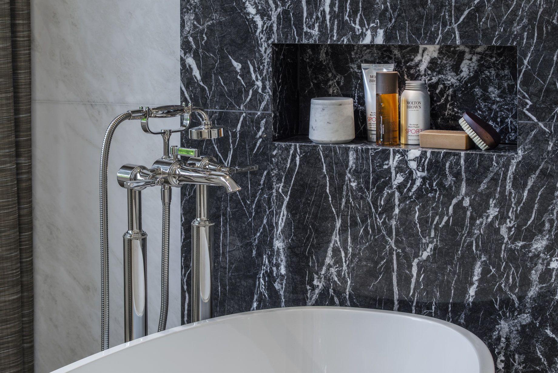 Provocative and powerful our design of his master bathroom juxtaposes black and white
