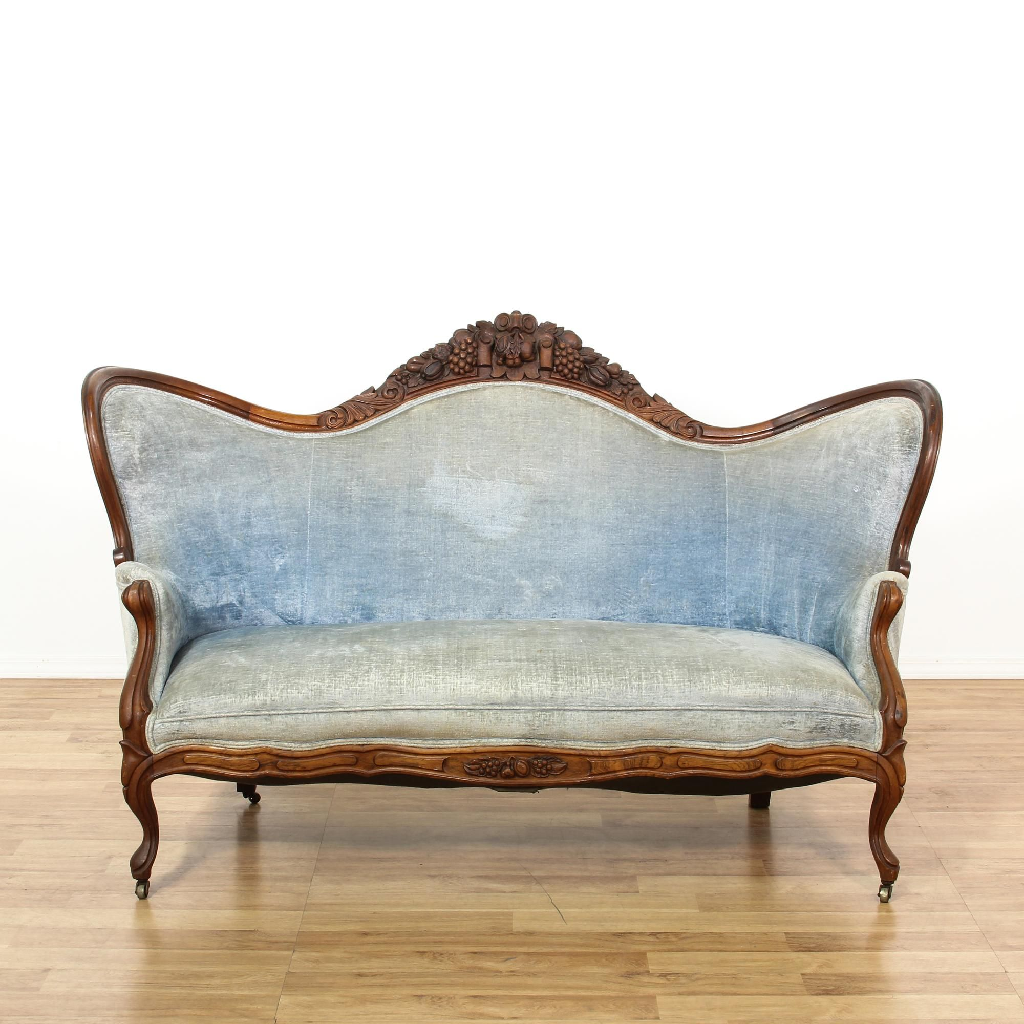 This belter victorian style settee is featured in a solid wood
