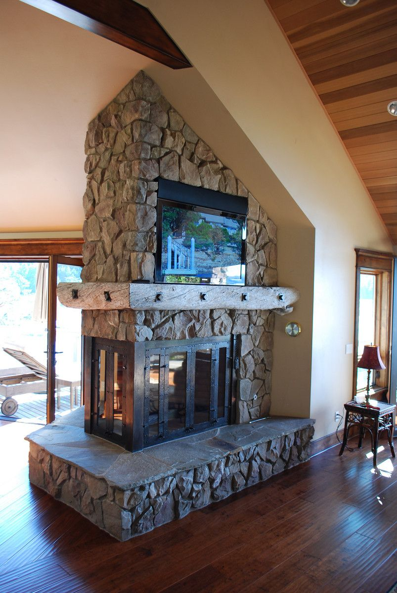 3 sided fireplace with bronze frame and doors island drift wood