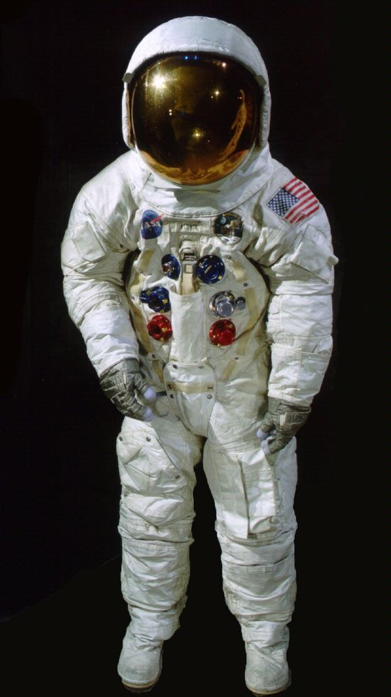 an astronaut in a space suit is motionless in outer space - photo #1