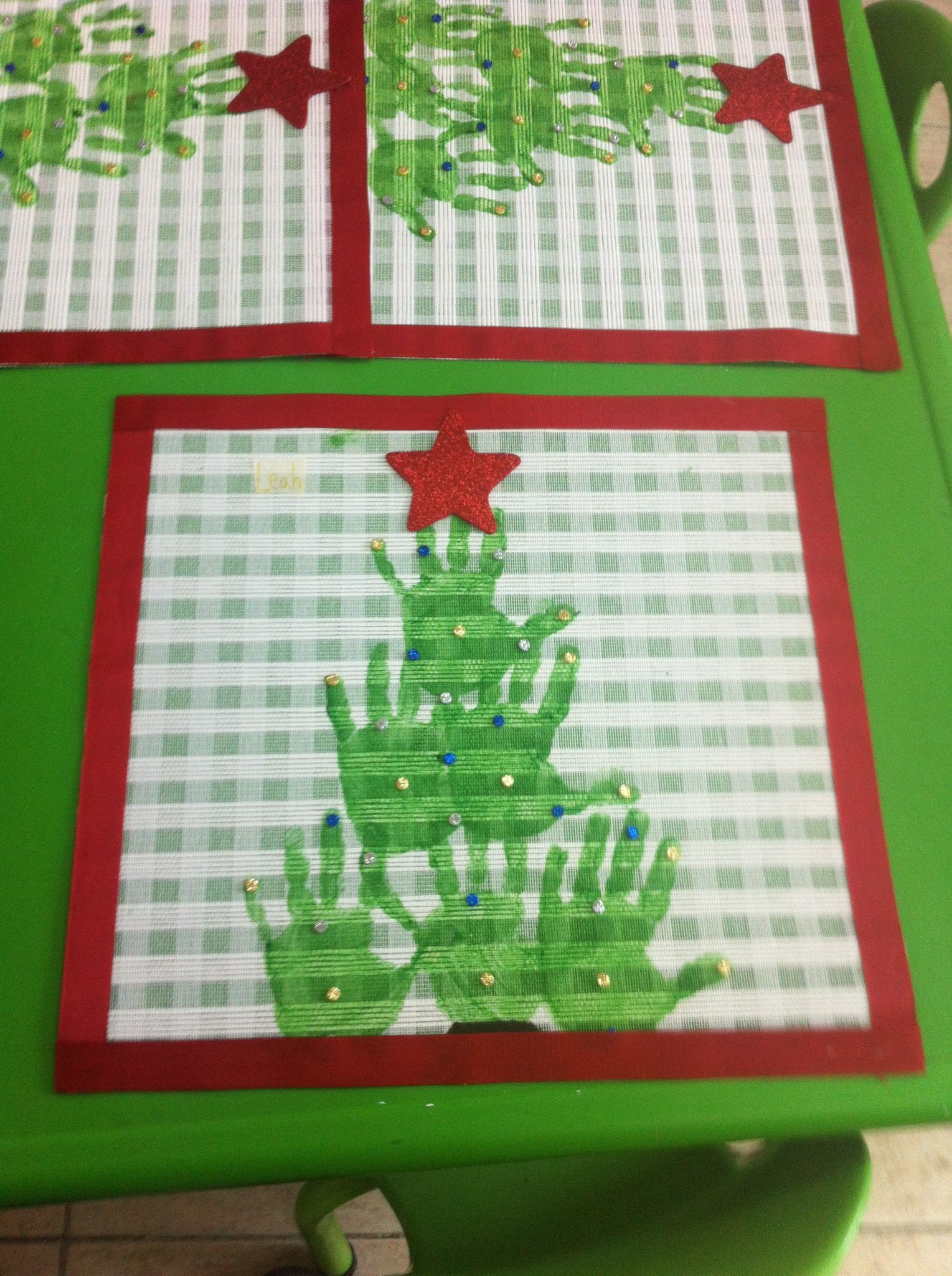 Another handprint craft Make holiday place mats with your kids