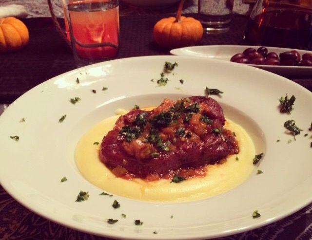 Veal ossobuco  with gremolata  over creamy polenta with mascarpone