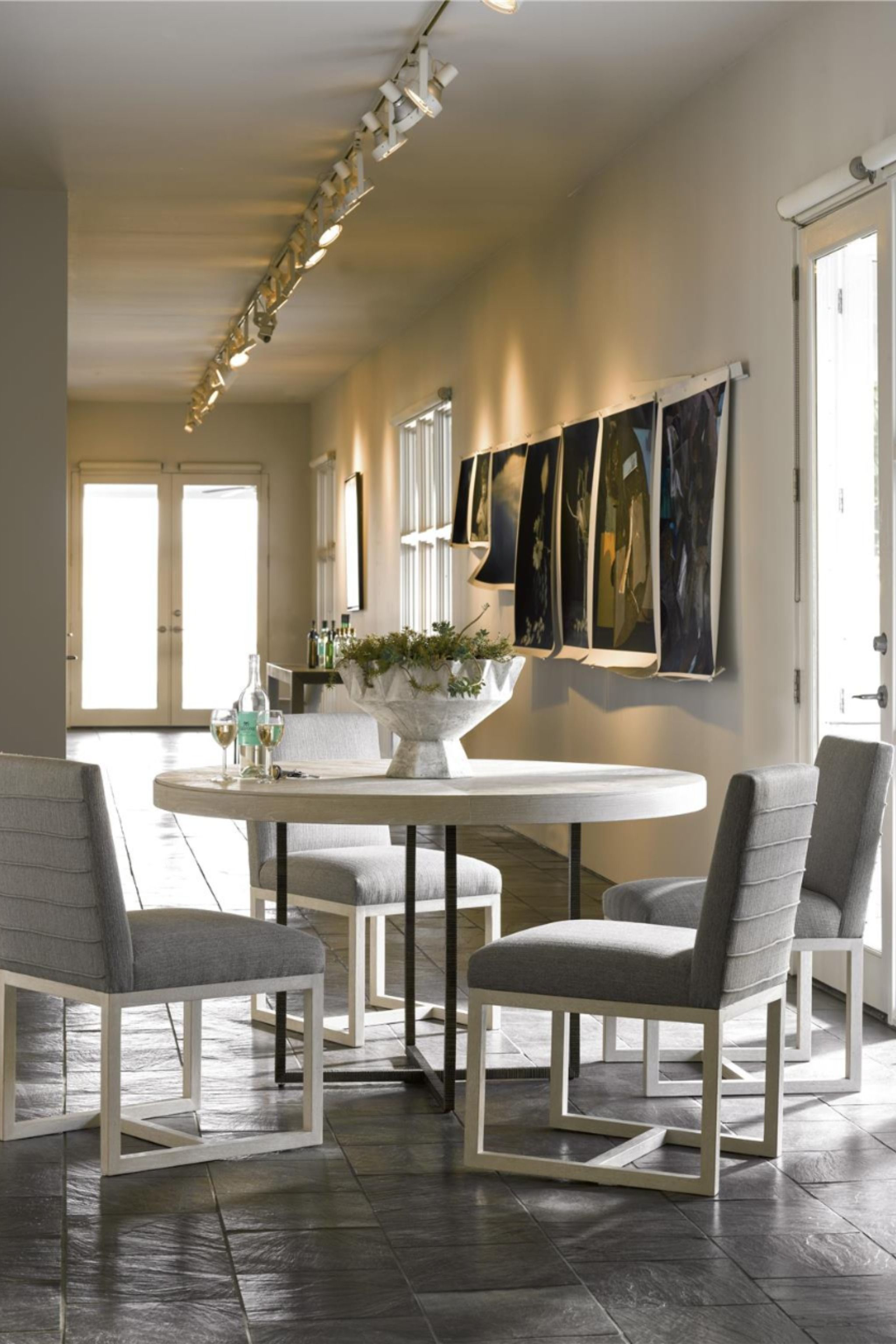 The Two Tone Robarbs Round Dining Table Will Bring An Airy Charm