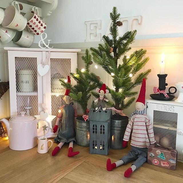 xmas trees pixies tin houses and black cast iron candle - A Country Christmas Cast