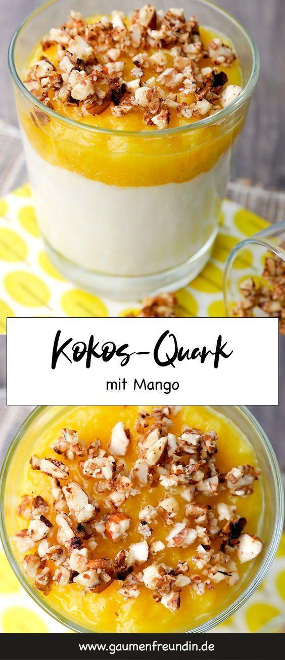 Köstlicher Kokos-Quark mit pürierter Mango und gehackten Nüssen - ein leckere... -