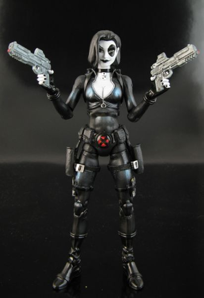 this is a marvel legends Domino Custom Action Figure she was made by figure realmer jin saotome he used a black widow body but you could use the new mystique body, danger girl abby chase, psylocke lower legs, movie masters bruce wayne prototype bat-suit straps, fantomex belt happy pinning