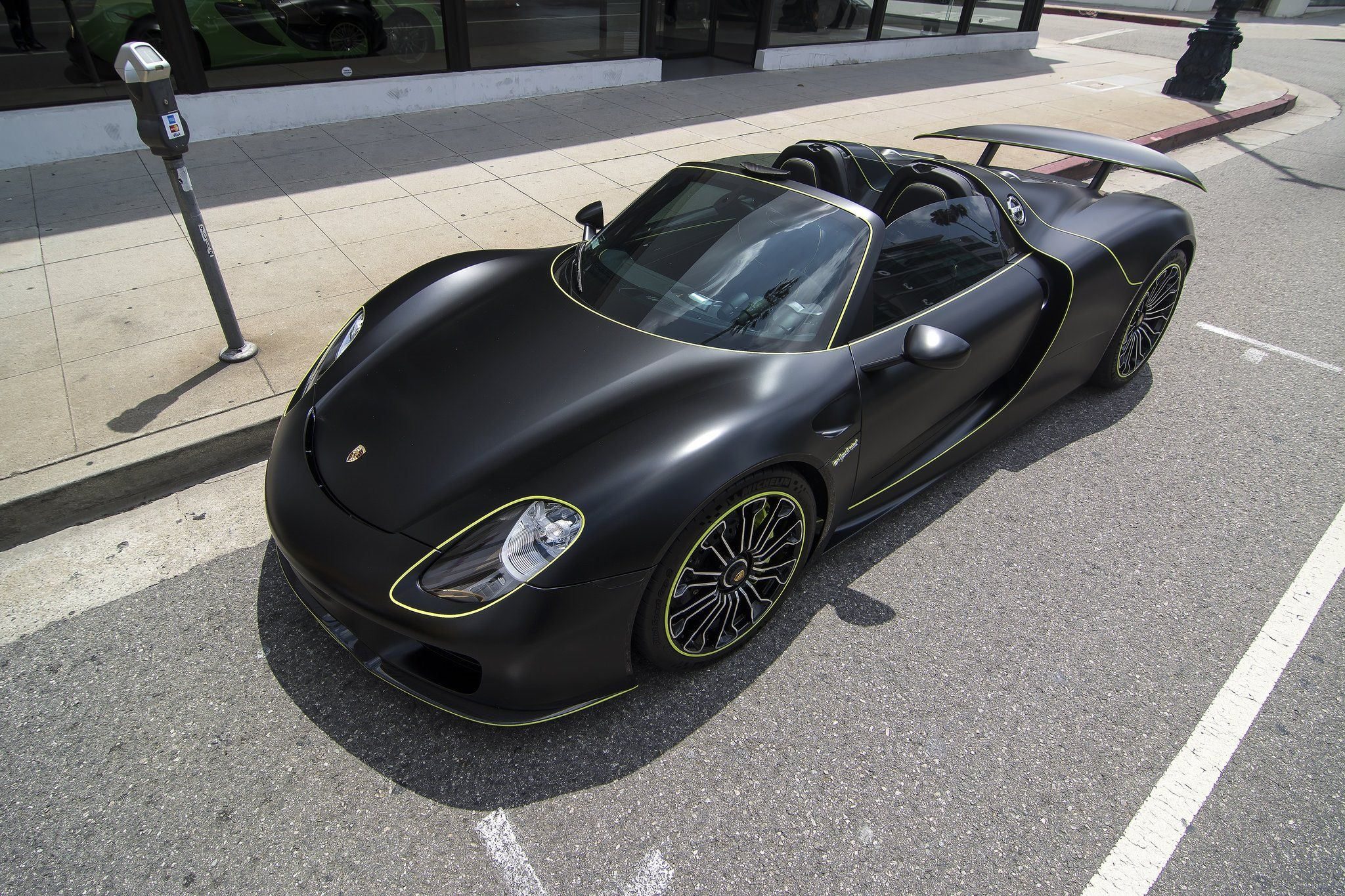 matte black and green porsche 918 spyder front three quarters