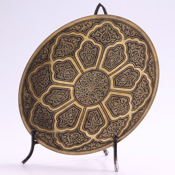 Crafted in the 14th century Timurid tradition of metal working this