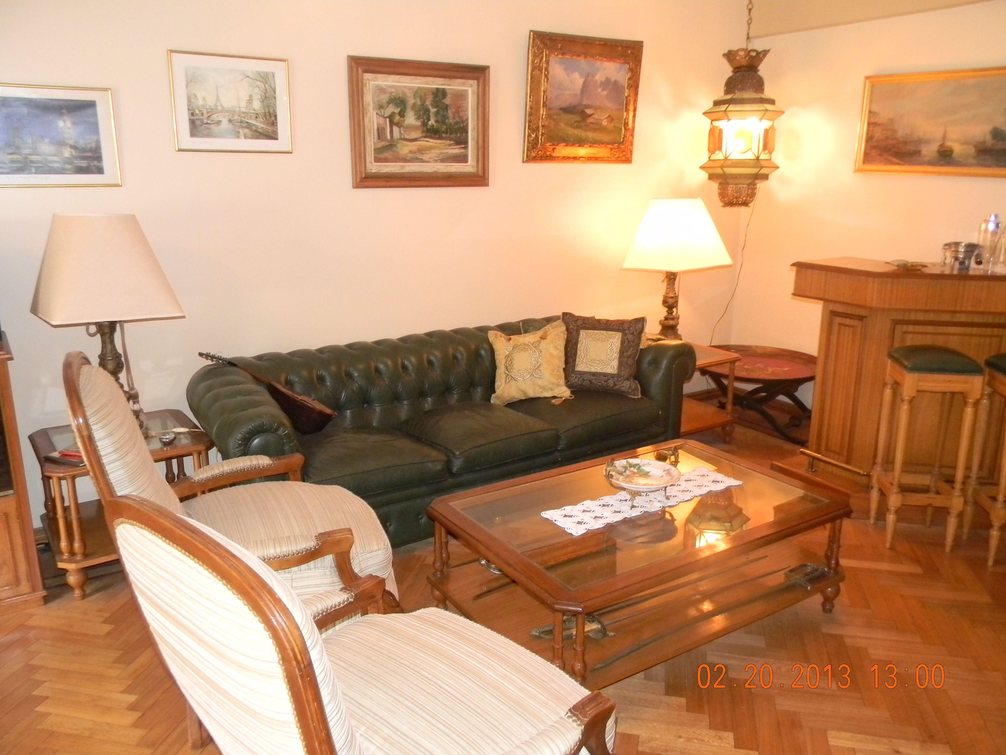 Estar clásico estilo Inglés Sofá Chesterfield en cuero y sillones