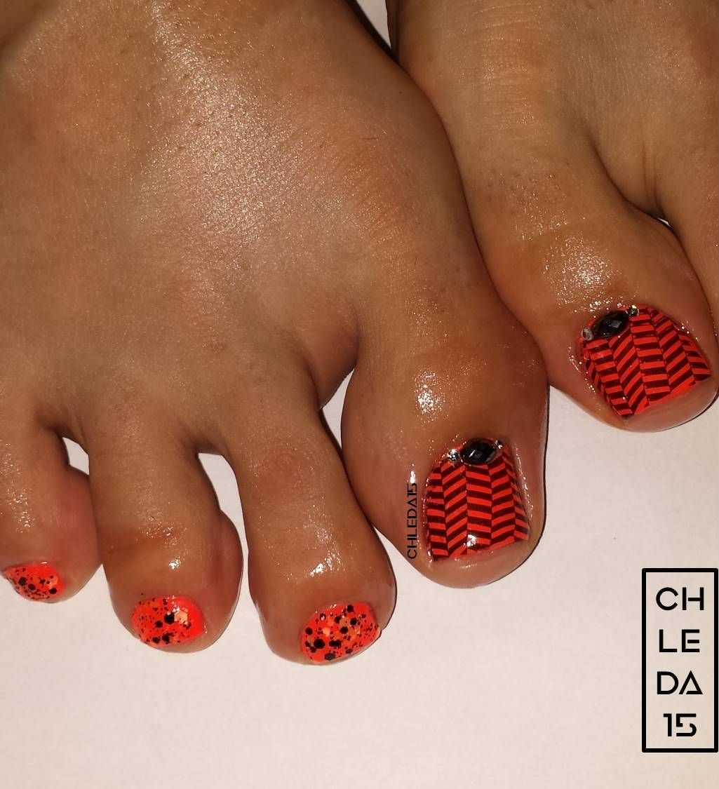 All nails painted neon orange as base. Big toenail with stamped ...