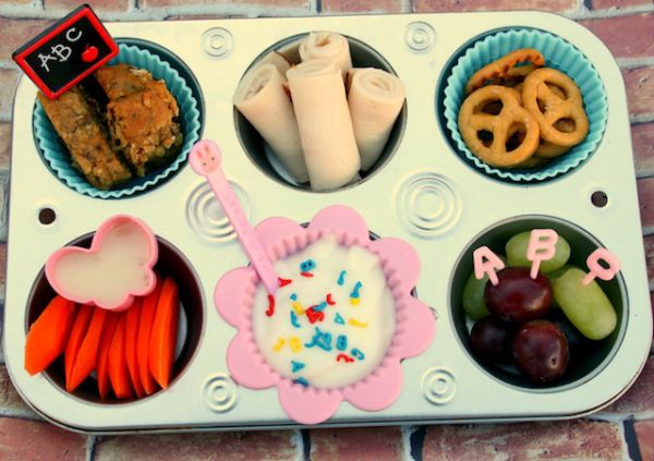 """Mealtime battles: We've all been there. So that's why we're filing muffin tin meals under """"Best Parenting Hacks of All Time."""" If you think about it, nothing could be more kid-friendly — small bites, lots of choices and … here's the biggie … teeny separate portions. So go ahead and table that cereal-for-dinner idea (we've been there too).Click through ouralbumandserve up healthy..."""