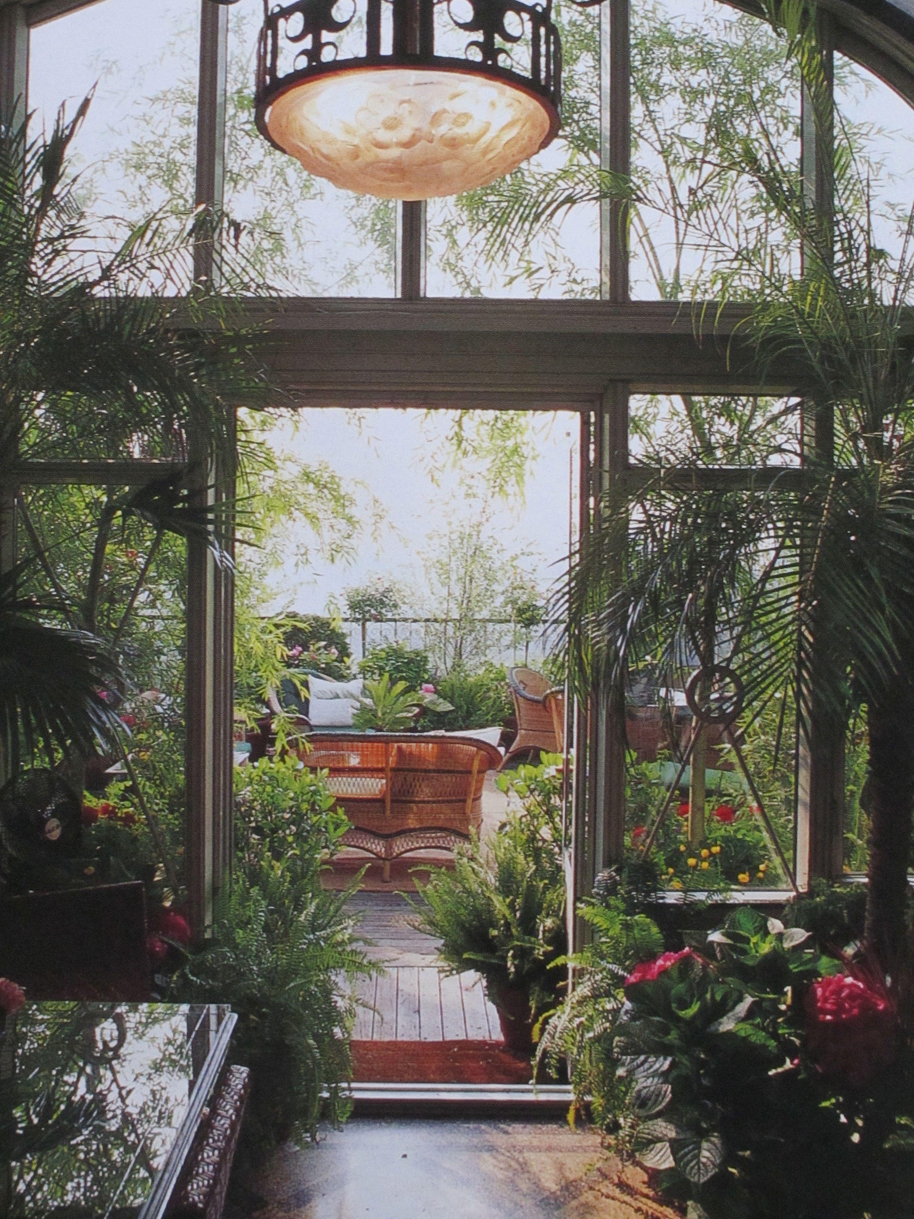 a look at the rooftop garden through the greenhouse door