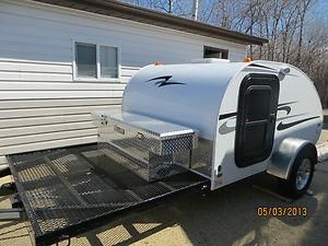 Little Guy trailer... With a deck for the bike