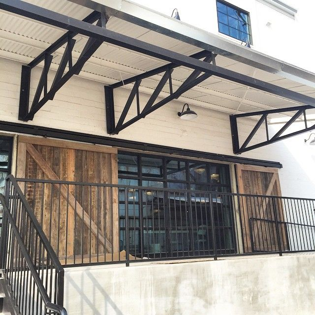 Shop doors are in at the Magnolia Silos! Can't wait to get the shop open soon! @magnoliamarket