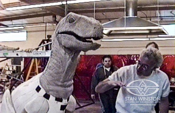 Stan Winston talks Rosengrant through an early raptor suit rehearsal for JURASSIC PARK.