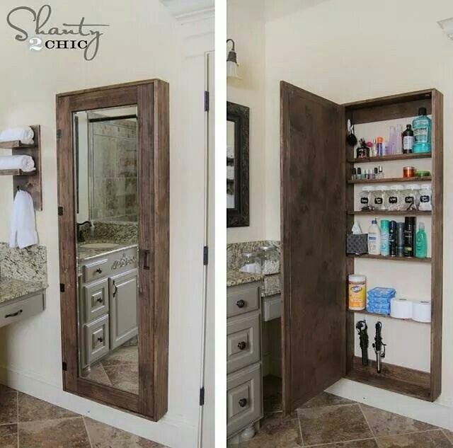 Mirrored Storage Cabinet Next To The Vanity Linen Closet In My