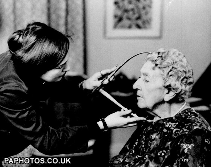Sculptor taking measurements to make a wax portrait for Madame Tussaud's, London