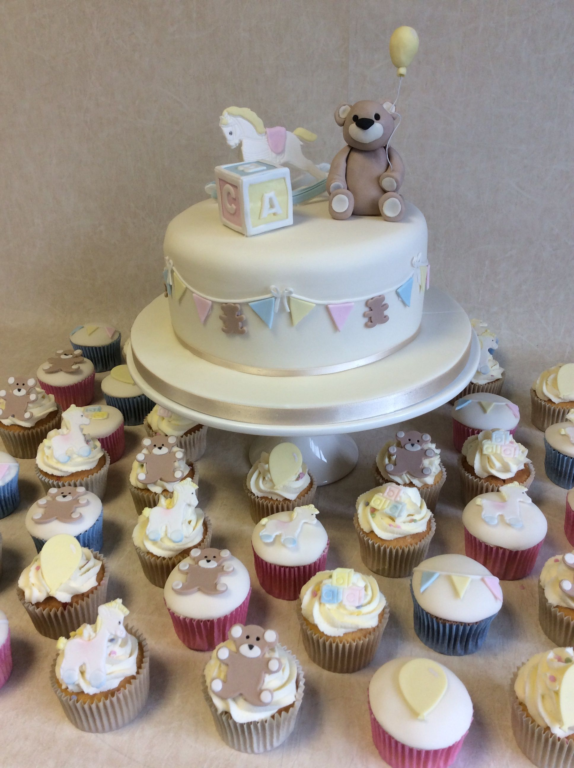Baby Shower cake with matching cup cakes to match Rock a Bye Baby