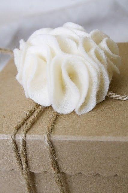 felt flower, twine, and kraft paper