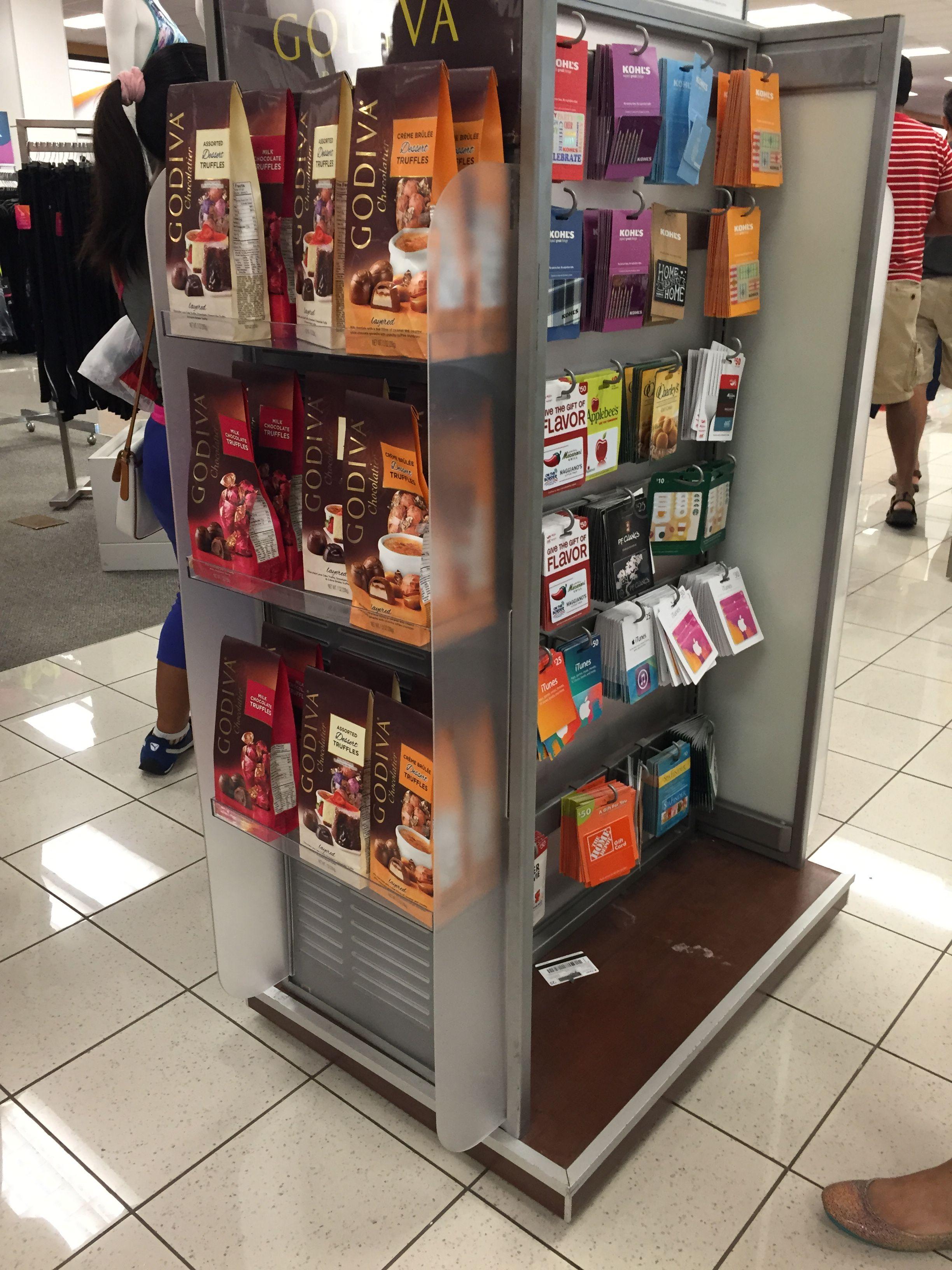 A chocolate and gift card shelf near the cashier Shelves