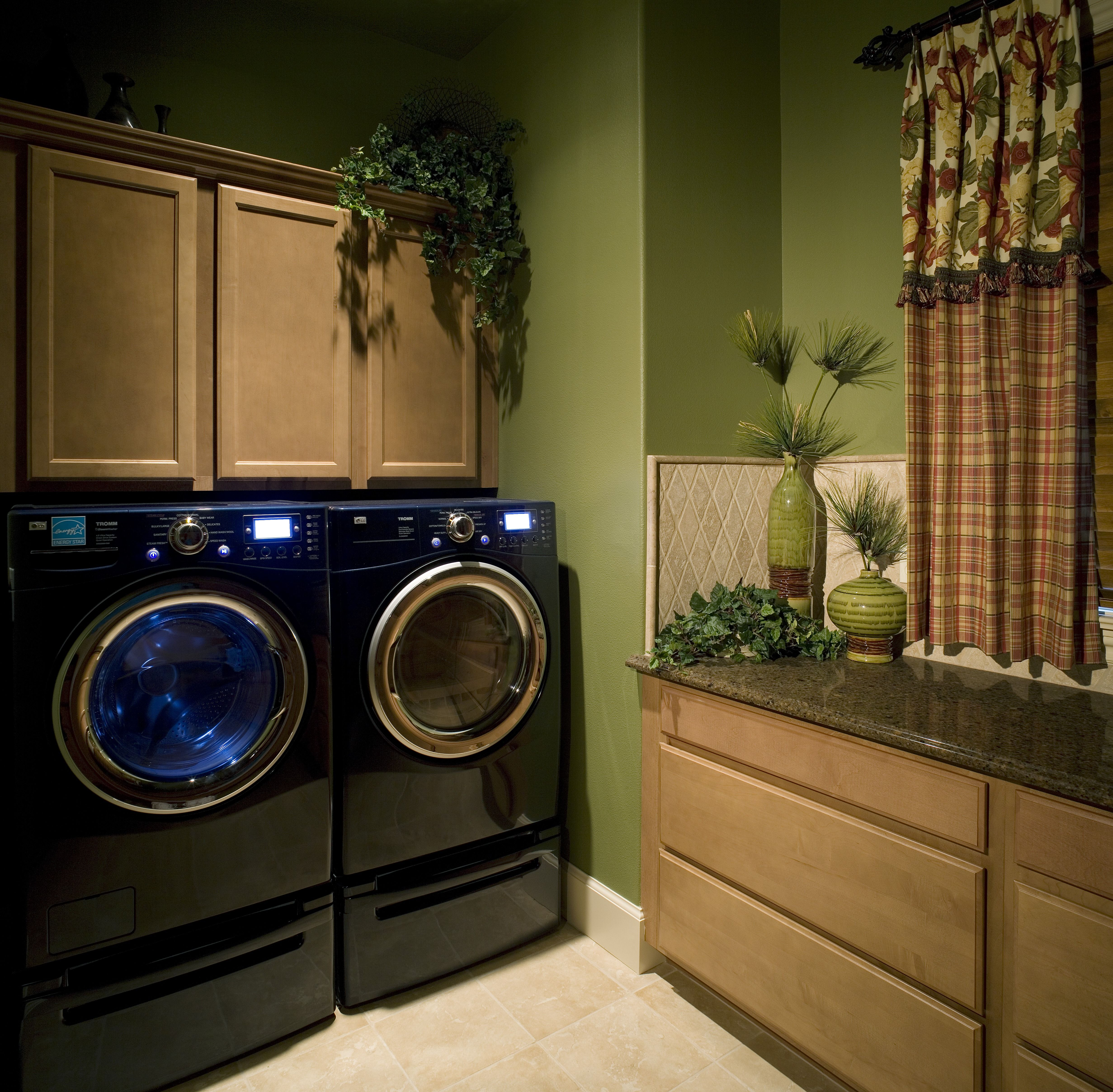 A Traditional Style Laundry Room With Dark Granite Countertops And Impressive Average Cost To Replace Kitchen Cabinets Inspiration Design