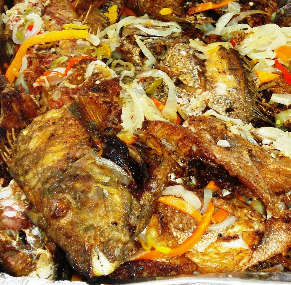 Fried escovitch fish with chopped onions and pepper a for Jamaican fish recipes