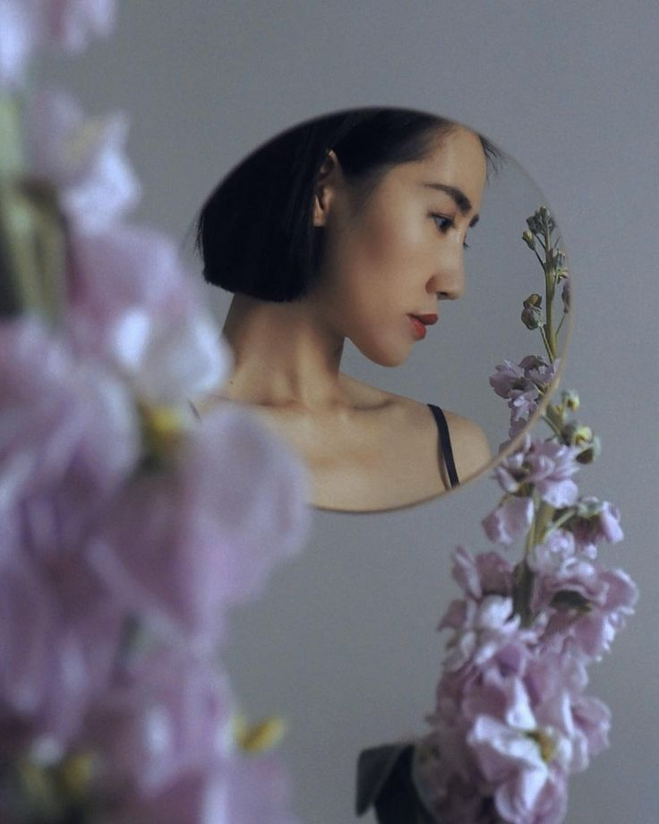 Photographer Creates Surreal Minimalist Self Portraits Surrounded By Flowers And Fruits Self Portrait Photography Self Portrait Poses Minimalist Photography