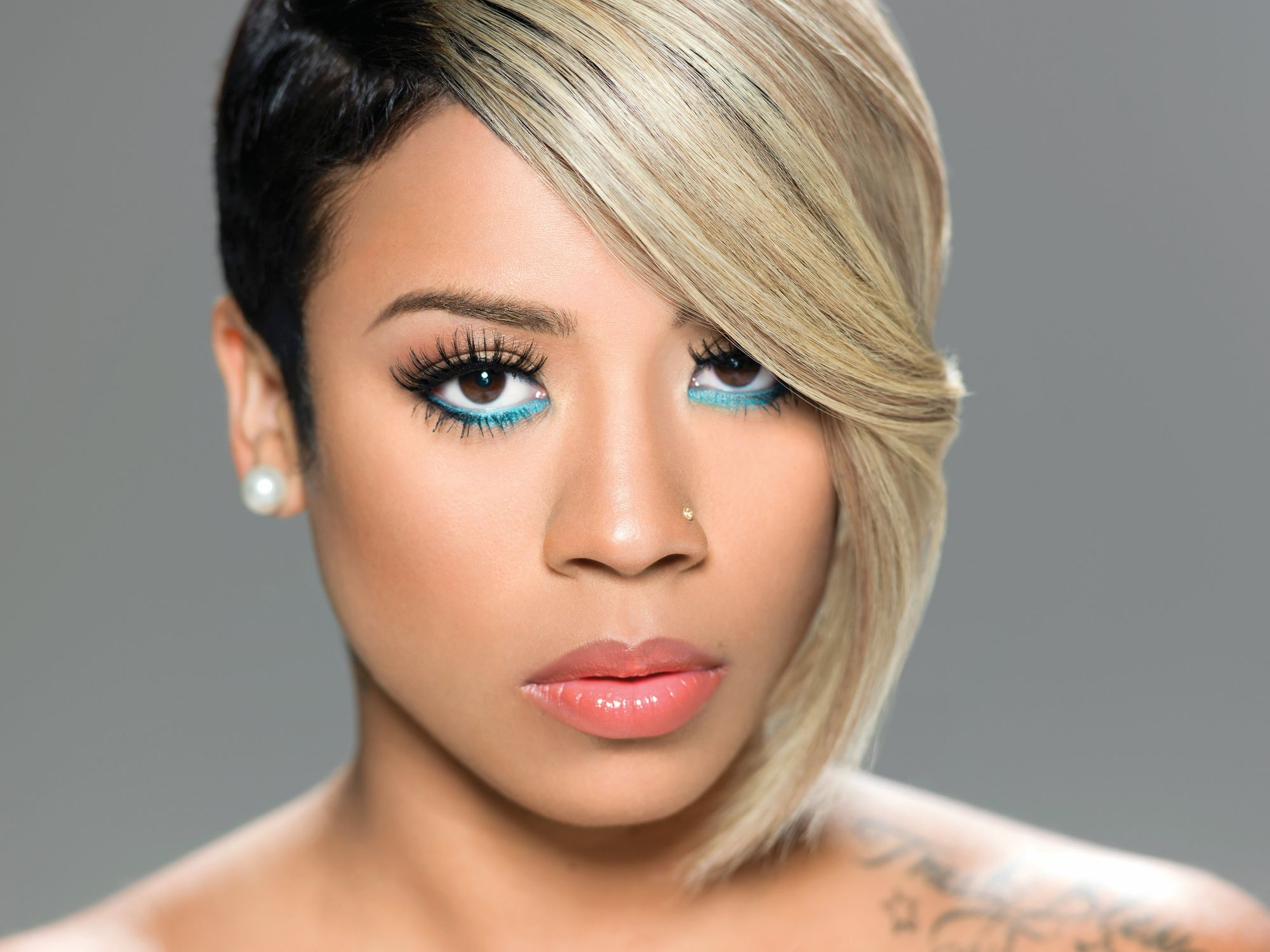 Talking about Keyshia Cole haircuts the singer has worn her hair in