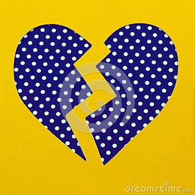 a blue heart with white polka dots on yellow background