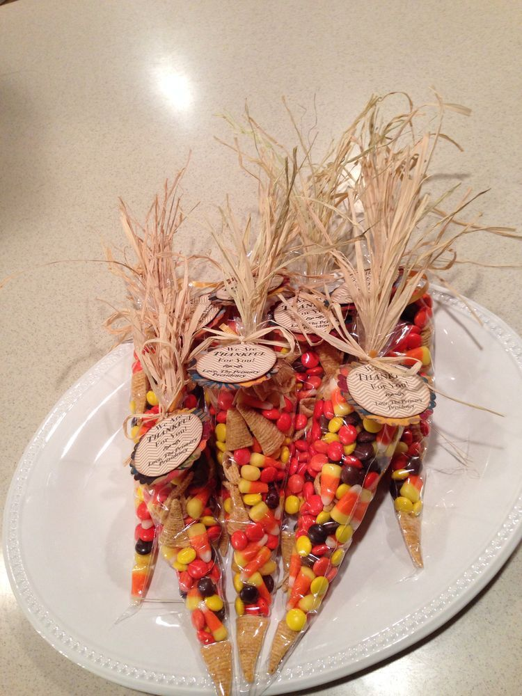 thanksgiving place setting or thank you gift i filled icing bags with a mix of reeses pieces candy corn and bugles add rafia to the top and tie with a