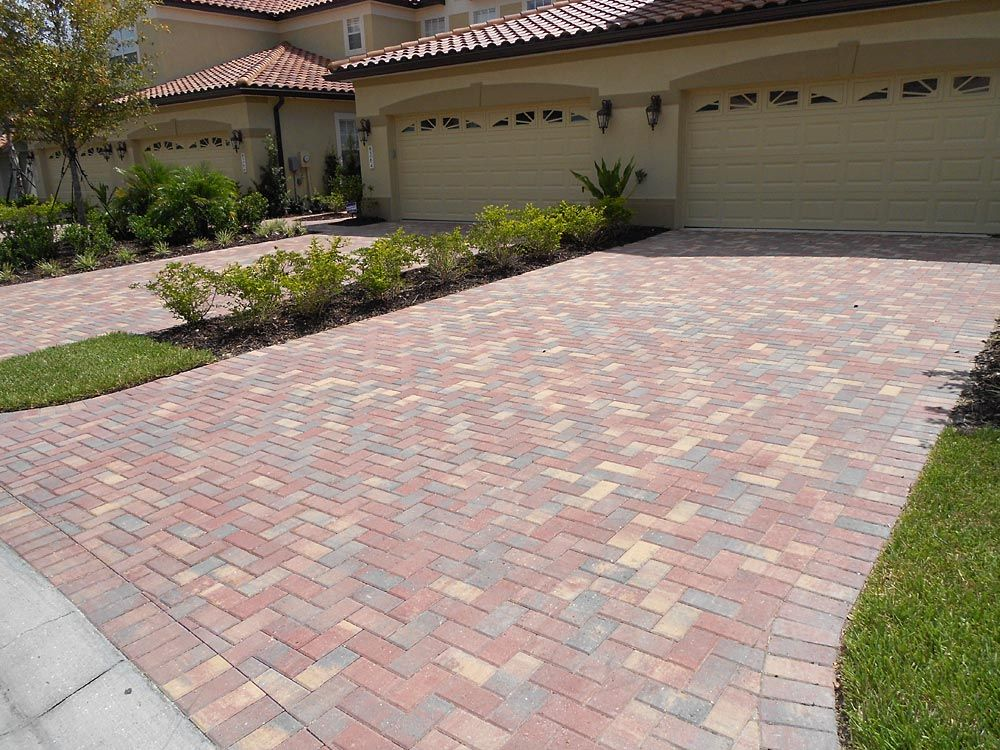 4x8 crimson rose brick paver driveway installed in a 90 degree