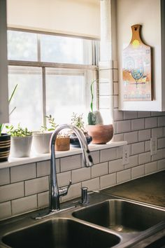 Making It Work In A Bare Bones Texas Home A Collection Of Succulents Sits On The Kitchen Windowsill 6 O With Images Kitchen Window Sill Kitchen Tiles Tiled Window Sill