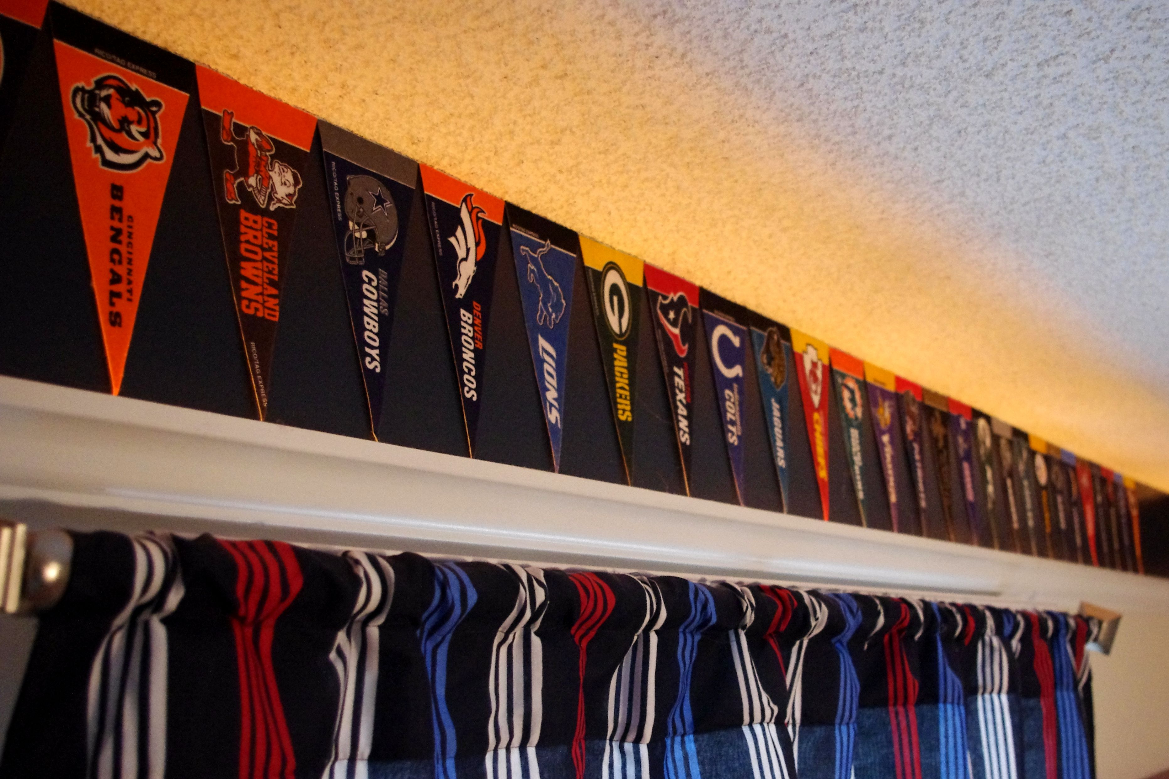 NFL Bedroom   Using Mini NFL Pennants And Command Strips.