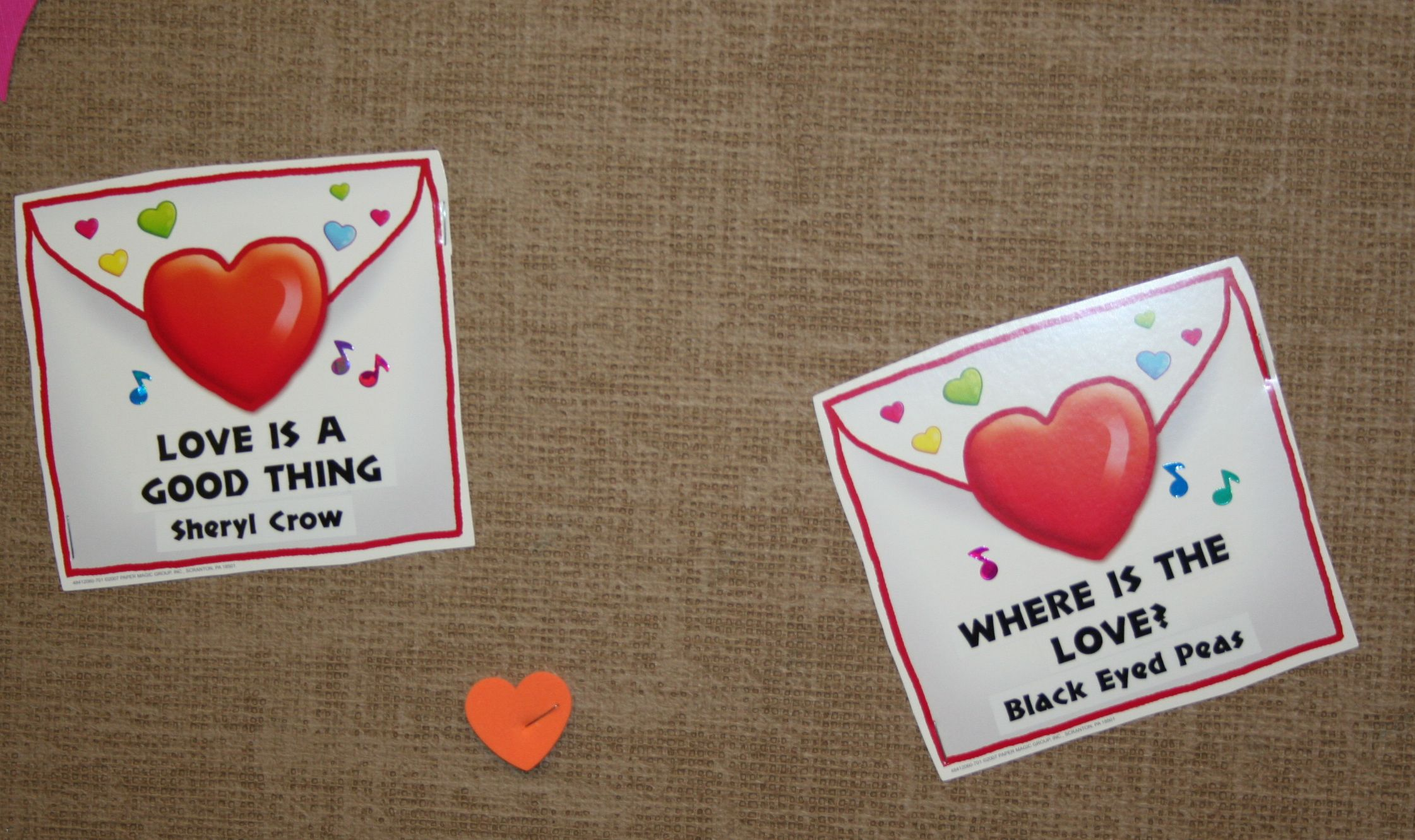 A close-up of the LOVE SONG bulletin board song cards