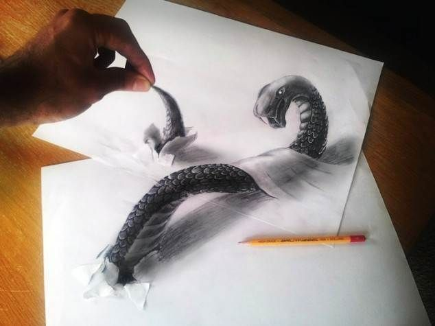 three dimensional optical illusion drawn in pencil torn paper artist real hand in picture