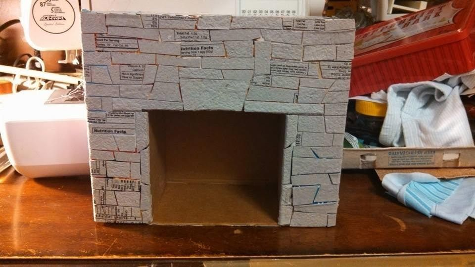 How to make a fake fireplace out of cardboard cardboard - How to put out a fireplace ...